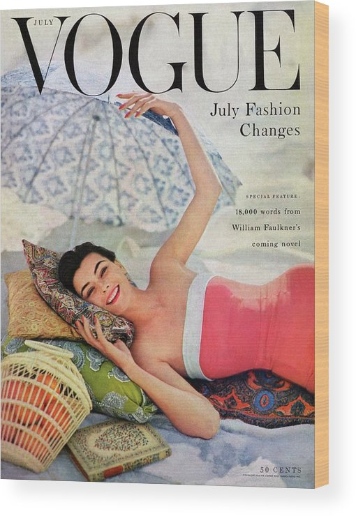Fashion Wood Print featuring the photograph A Vogue Cover Of Anne Gunning Under An Umbrella by Karen Radkai