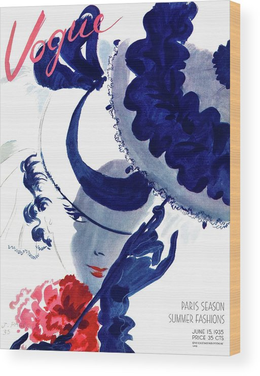 Illustration Wood Print featuring the photograph Vogue Magazine Cover Featuring A Woman Holding by Jean Pages