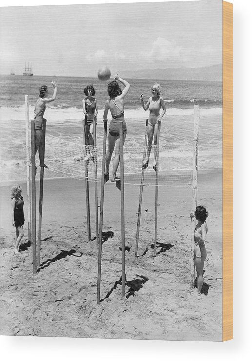 1930's Wood Print featuring the photograph Volleyball On Stilts by Underwood Archives