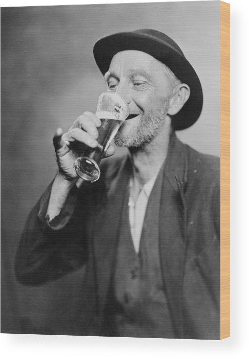 History Wood Print featuring the photograph Happy Old Man Drinking Glass Of Beer by Everett