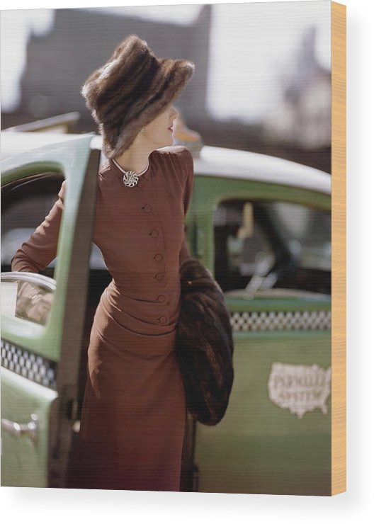 Fashion Wood Print featuring the photograph A Model Getting Out Of A Cab by Constantin Joffe
