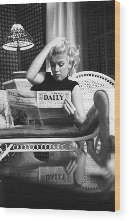 People Wood Print featuring the photograph Marilyn Relaxes In A Hotel Room by Michael Ochs Archives