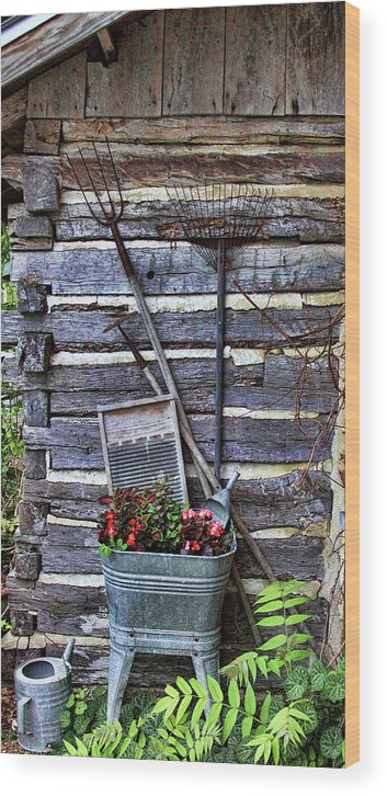 Creative Wood Print featuring the photograph Tall Log Cabin And Garden Tools by Linda Phelps
