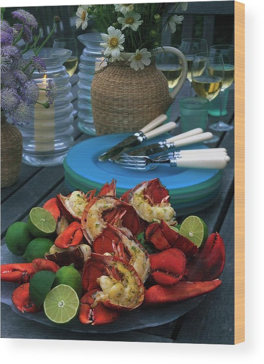 Still Life Wood Print featuring the photograph A Meal With Lobster And Limes by Romulo Yanes