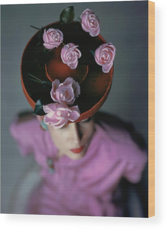Accessories Wood Print featuring the photograph A Model Wearing A Bonwit Teller Hat by John Rawlings