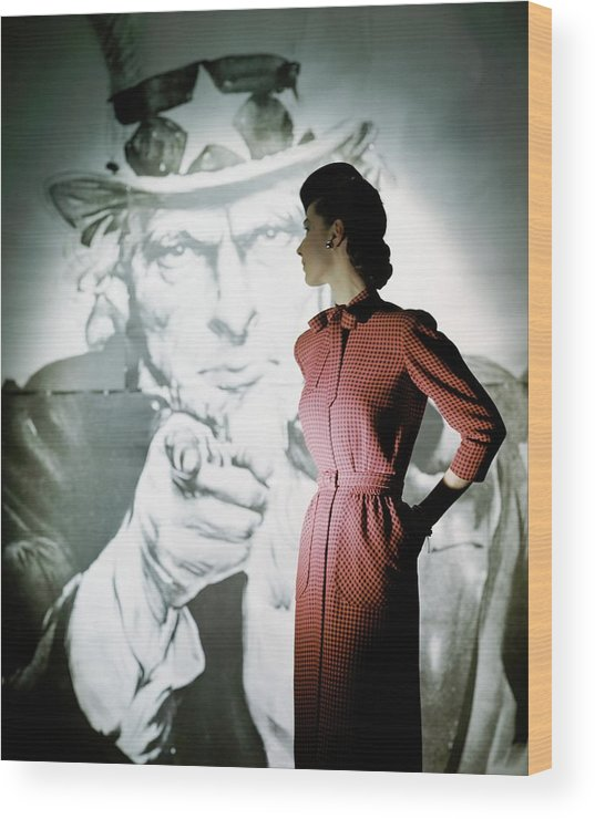 Fashion Wood Print featuring the photograph A Model Wearing A Checked Dress by John Rawlings