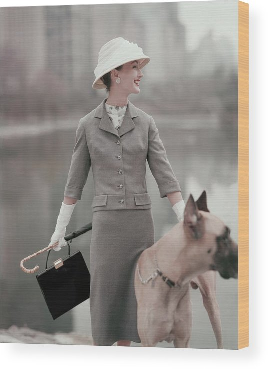 Fashion Wood Print featuring the photograph A Model Wearing A Gray Suit With A Dog by Karen Radkai
