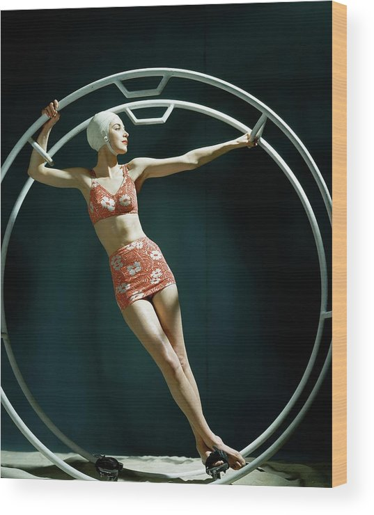 Swimwear Wood Print featuring the photograph A Model Wearing A Swimsuit In An Exercise Ring by John Rawlings