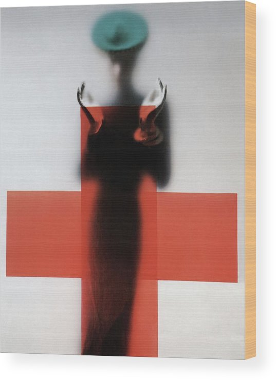 Fashion Wood Print featuring the photograph A Woman Standing Behind A Red Cross On Frosted by Erwin Blumenfeld