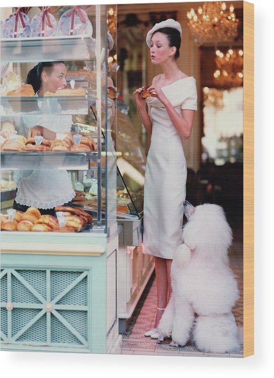 Accessories Wood Print featuring the photograph Audrey Marnay At A Patisserie With A Poodle by Arthur Elgort