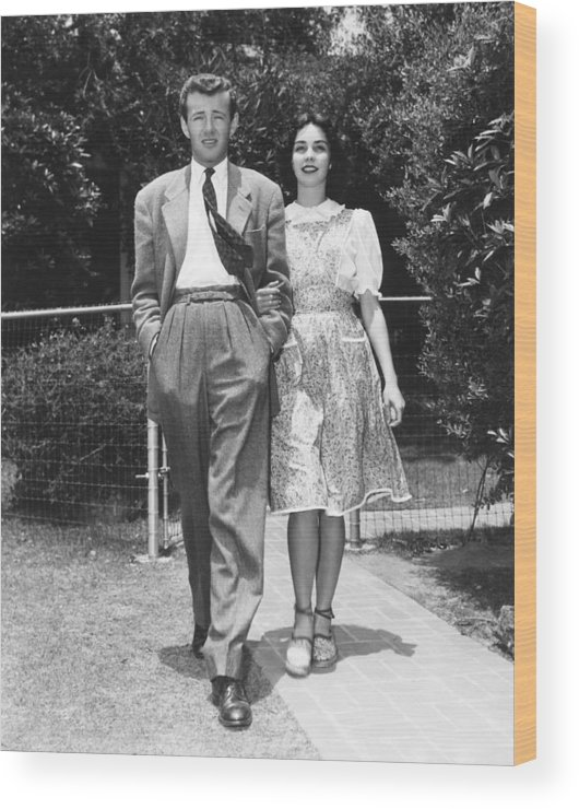 1940s Candid Wood Print featuring the photograph From Left, Spouses Robert Walker by Everett