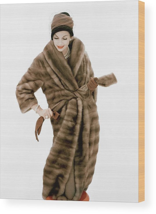 23c513b1a28 Model Wearing A Fur Coat And Hat By Lilly Dache Wood Print by Henry Clarke