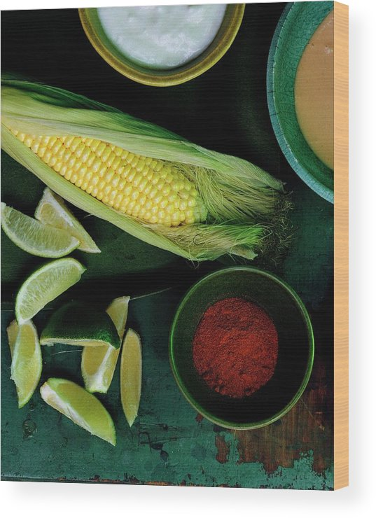 Fruits Wood Print featuring the photograph Sweetcorn And Limes by Romulo Yanes