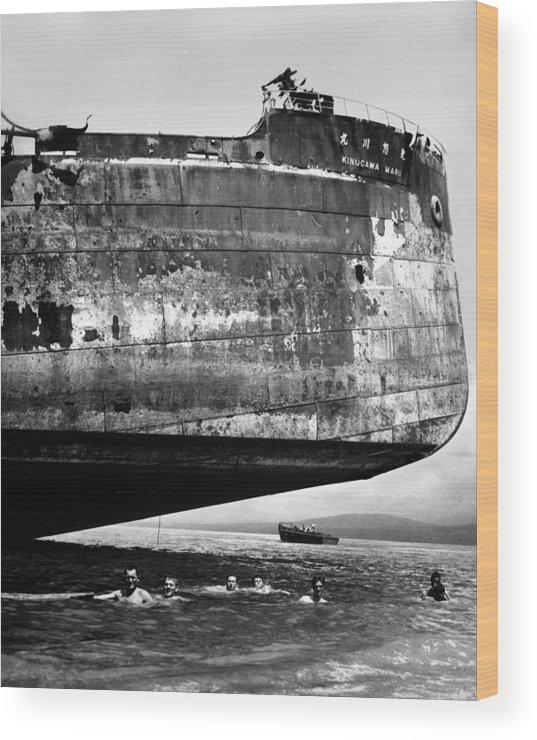 History Wood Print featuring the photograph U.s. Coast Guardsmen Swim by Everett
