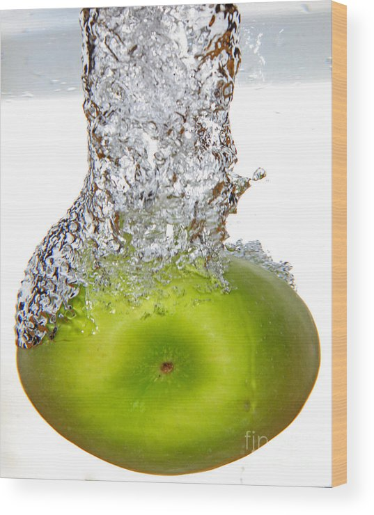 Water Wood Print featuring the photograph Handy Green Apple by Lloyd Alexander
