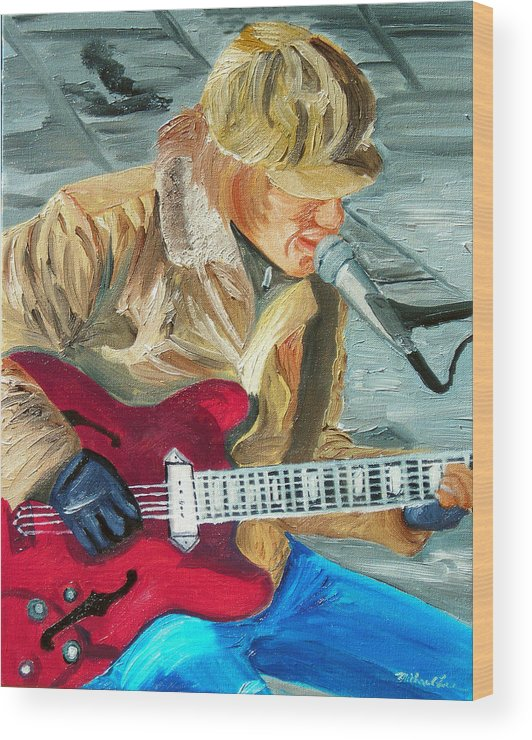 Street Musician Wood Print featuring the painting A Cold Day To Play by Michael Lee