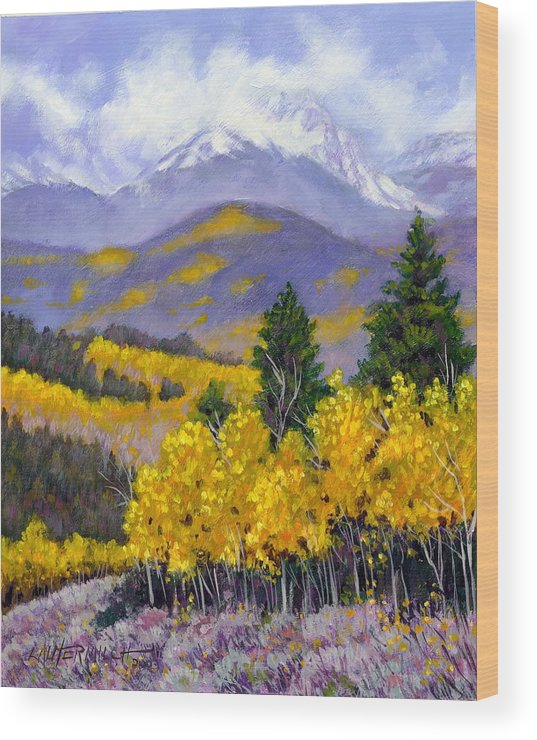 Rocky Mountains Wood Print featuring the painting Snowing In The Mountains by John Lautermilch