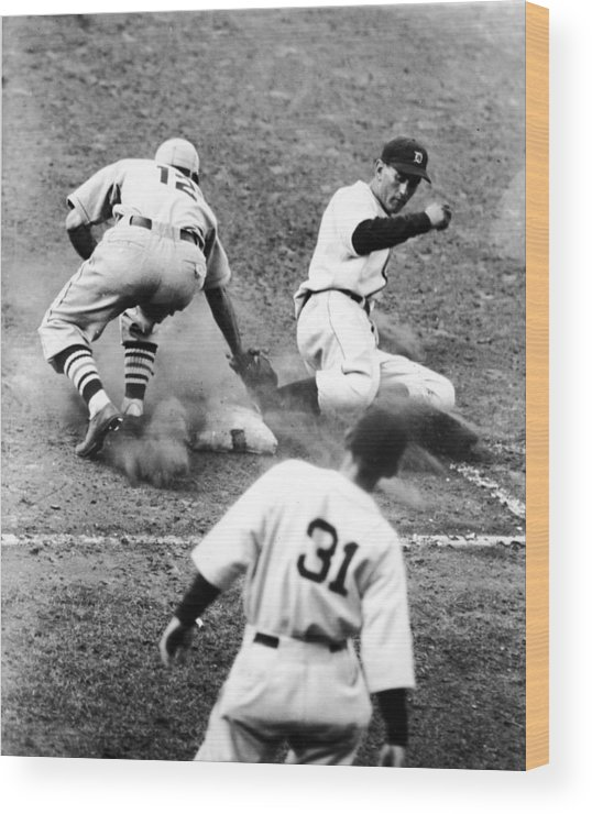 St. Louis Cardinals Wood Print featuring the photograph Charlie Gehringer Slides Into First Base by Fpg