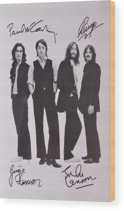 The Beatles Wood Print featuring the photograph The Beatles by Donna Wilson