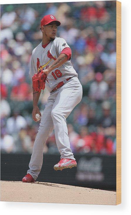 St. Louis Cardinals Wood Print featuring the photograph St Louis Cardinals V Colorado Rockies by Doug Pensinger