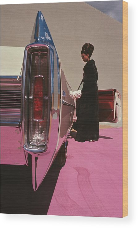 Auto Wood Print featuring the photograph A Model Wearing Emeric Partos Entering A 1965 by Gene Laurents