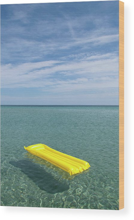 Tranquil Scene Wood Print featuring the photograph A Yellow Inflatable Raft Floating On by Caspar Benson