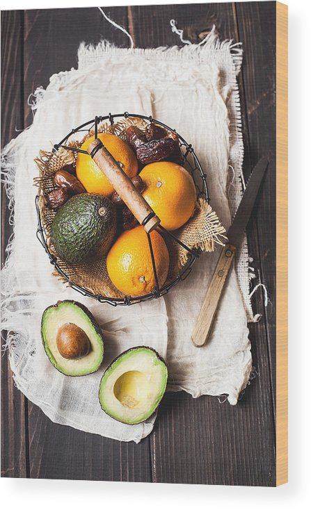 San Francisco Wood Print featuring the photograph Basket With Avocado, Oranges And Dates by One Girl In The Kitchen