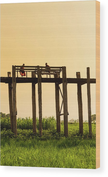 Grass Wood Print featuring the photograph Buddhist Monks Seated On U Bein Bridge by Merten Snijders