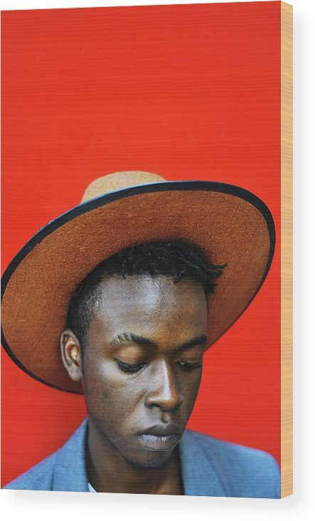 Young Men Wood Print featuring the photograph Close-up Of Man Wearing Hat Against Red by Samson Wamalwa / Eyeem