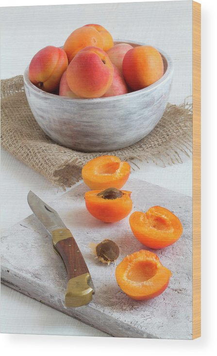 Cutting Board Wood Print featuring the photograph Cross Section Apricots With Knife And by Westend61