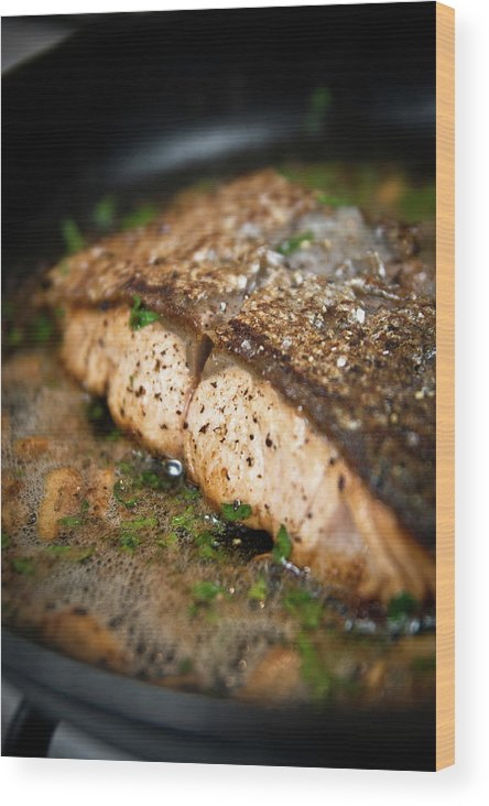 Garlic Wood Print featuring the photograph Frying Salmon On Pan by Wojciech Wisniewski