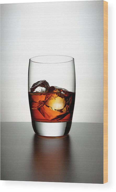 White Background Wood Print featuring the photograph Glass With Brown Liquor And Ice Cubes by Chris Stein
