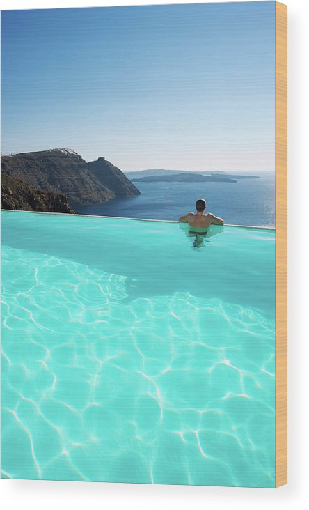 People Wood Print featuring the photograph Man Relaxing Looking At Santorini by Peskymonkey