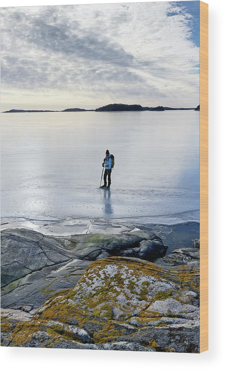 Archipelago Wood Print featuring the photograph Person Skating At Frozen Sea by Johner Images