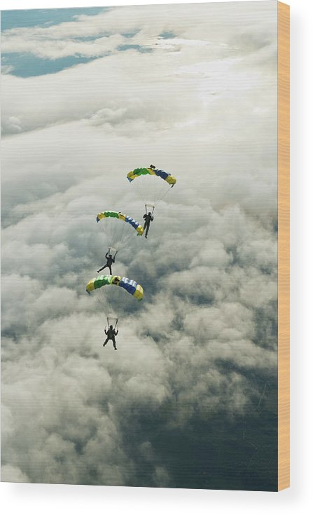 Young Men Wood Print featuring the photograph Skydivers In Mid-air by Johner Images