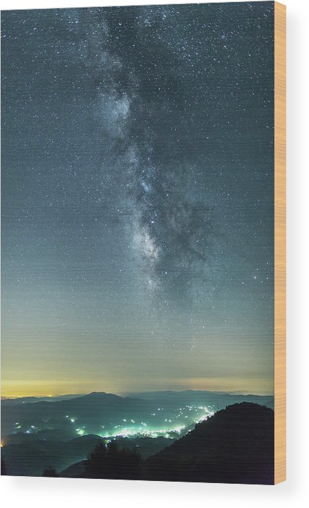 Scenics Wood Print featuring the photograph The Milky Way Hovering Above A Town by Trevor Williams