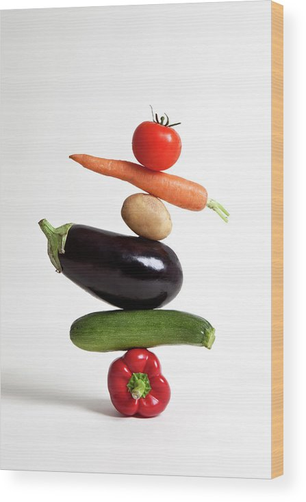 Shadow Wood Print featuring the photograph Vegetables Arranged In A Stack by Halfdark