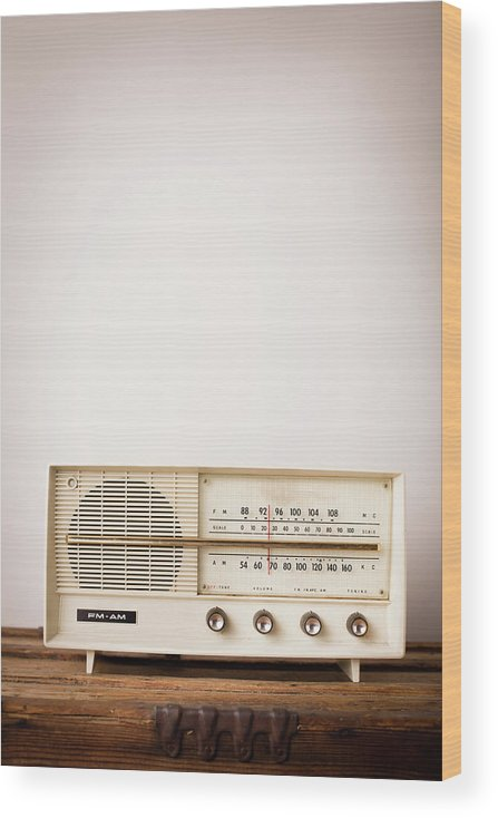 Desaturated Wood Print featuring the photograph Vintage Beige Radio Sitting On Wood by Ideabug