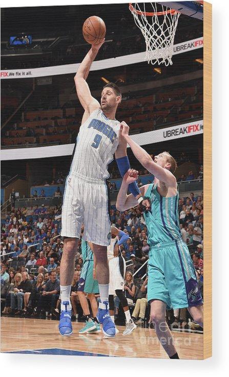 Nba Pro Basketball Wood Print featuring the photograph Charlotte Hornets V Orlando Magic by Gary Bassing