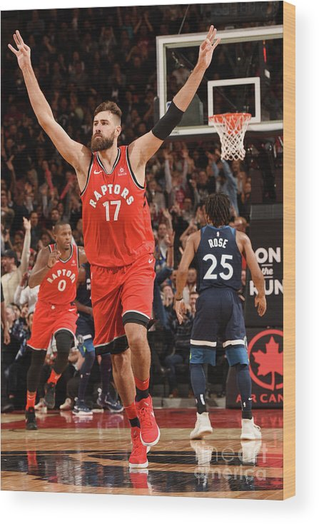 Nba Pro Basketball Wood Print featuring the photograph Minnesota Timberwolves V Toronto Raptors by Ron Turenne
