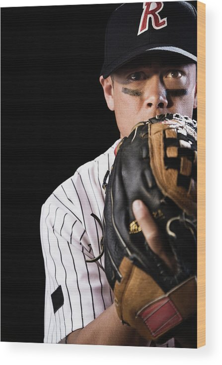 Baseball Cap Wood Print featuring the photograph Mixed Race Baseball Player Pitching by Hill Street Studios
