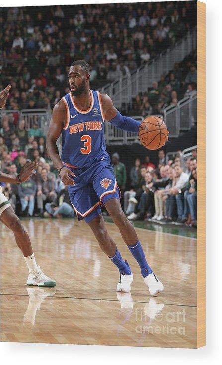 Tim Hardaway Jr. Wood Print featuring the photograph New York Knicks V Milwaukee Bucks by Gary Dineen