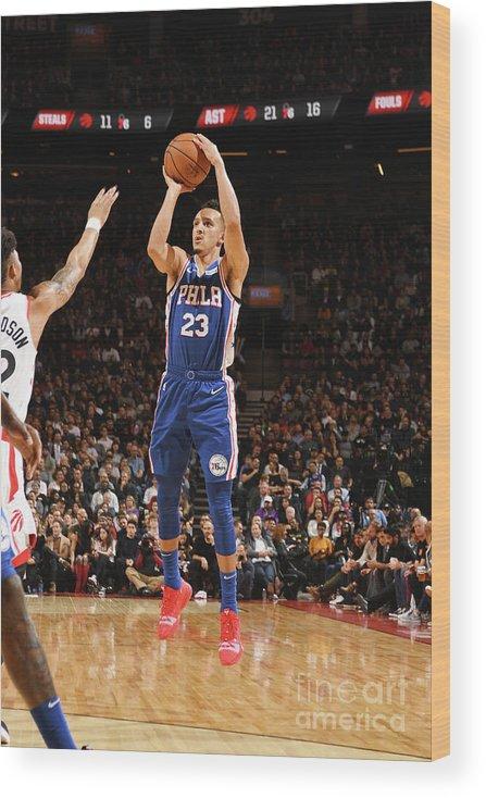 Nba Pro Basketball Wood Print featuring the photograph Philadelphia 76ers V Toronto Raptors by Ron Turenne
