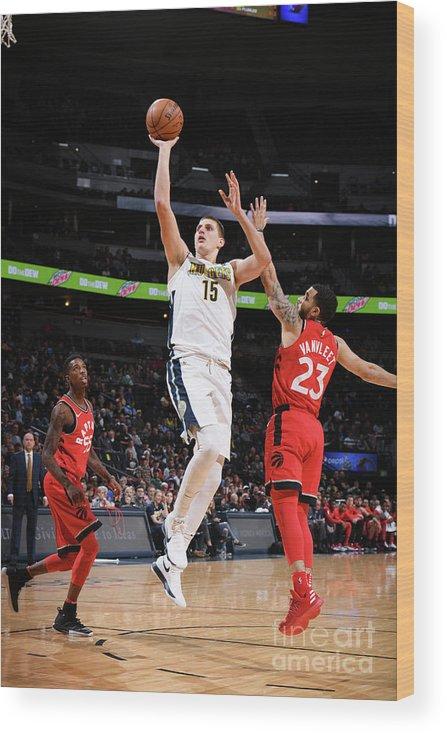 Nba Pro Basketball Wood Print featuring the photograph Toronto Raptors V Denver Nuggets by Garrett Ellwood
