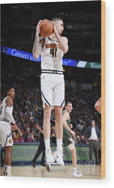 Nba Pro Basketball Wood Print featuring the photograph Milwaukee Bucks V Denver Nuggets by Garrett Ellwood