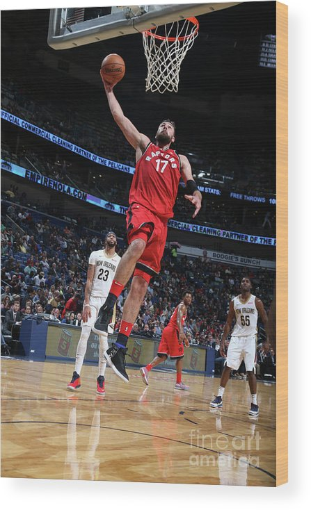 Smoothie King Center Wood Print featuring the photograph Toronto Raptors V New Orleans Pelicans by Layne Murdoch Jr.