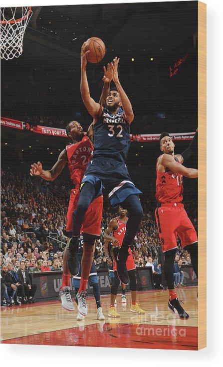 Nba Pro Basketball Wood Print featuring the photograph Minnesota Timberwolves V Toronto Raptors by Ron Turenne