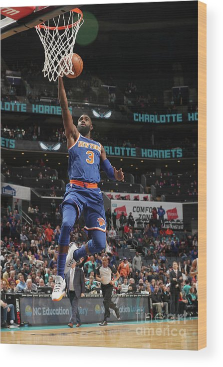 Tim Hardaway Jr. Wood Print featuring the photograph New York Knicks V Charlotte Hornets by Kent Smith