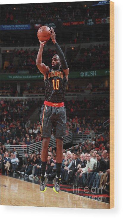 Tim Hardaway Jr. Wood Print featuring the photograph Atlanta Hawks V Chicago Bulls by Jeff Haynes