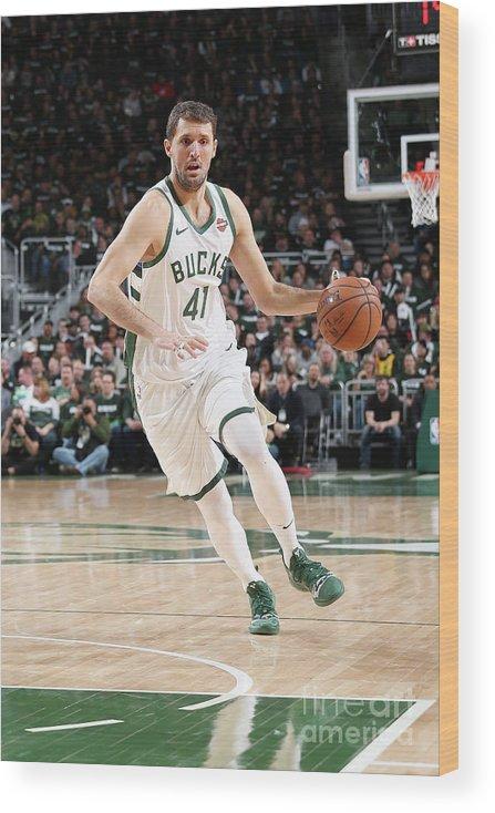 Playoffs Wood Print featuring the photograph Detroit Pistons V Milwaukee Bucks - by Gary Dineen